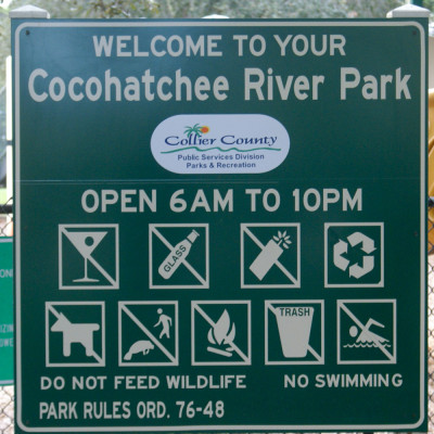 Playground sign in Cocohatchee River Park near The Ship Store